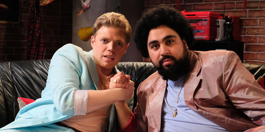 Rob Beckett's Playing For Time. Image shows from L to R: Rob Beckett, Asim Chaudhry. Copyright: Rumpus Media.