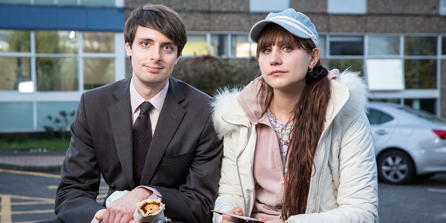 Stath Lets Flats. Image shows from L to R: Al (Alastair Roberts), Sophie (Natasia Demetriou). Copyright: Roughcut Television.