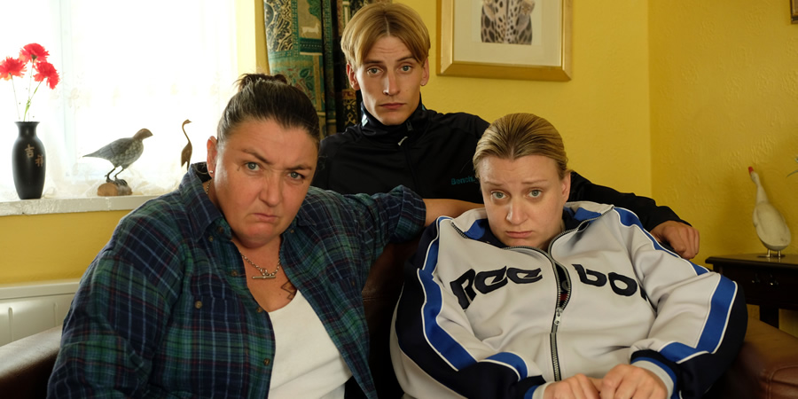 This Country. Image shows from L to R: Mandy Harris (Ashley McGuire), Lee 'Kurtan' Mucklowe (Charlie Cooper), Kerry Mucklowe (Daisy May Cooper). Copyright: BBC.