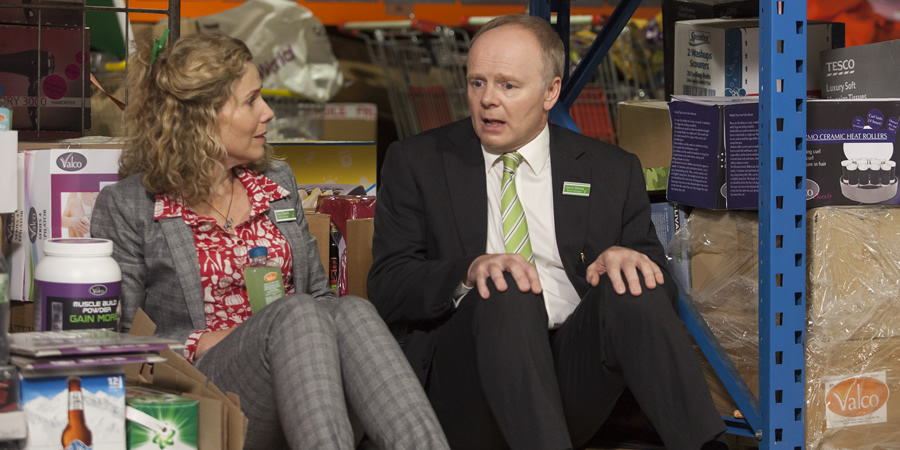 Trollied. Image shows from L to R: Lou (Sally Phillips), Gavin (Jason Watkins). Copyright: Roughcut Television.