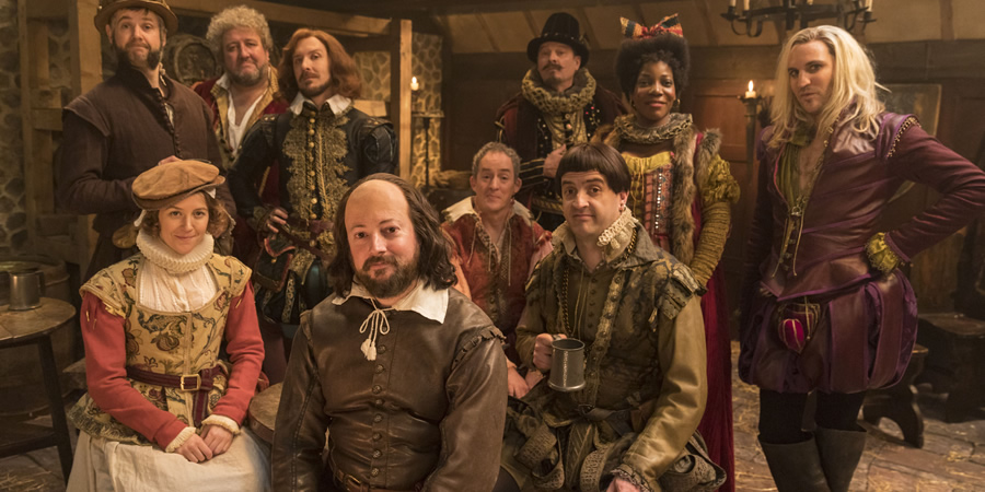 Upstart Crow. Image shows from L to R: Bottom (Rob Rouse), Kate (Gemma Whelan), Burbage (Steve Speirs), Marlowe (Tim Downie), Will Shakespeare (David Mitchell), Condell (Dominic Coleman), Sir Robert Greene (Mark Heap), Kempe (Spencer Jones), Lucy (Jocelyn Jee Esien), Morley (Noel Fielding). Copyright: BBC.