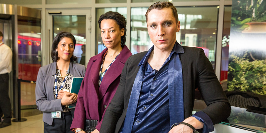 W1A. Image shows from L to R: Faiza Raja (Priyanga Burford), Lucy Freeman (Nina Sosanya), Ryan Chelford (Ben Batt). Copyright: BBC.