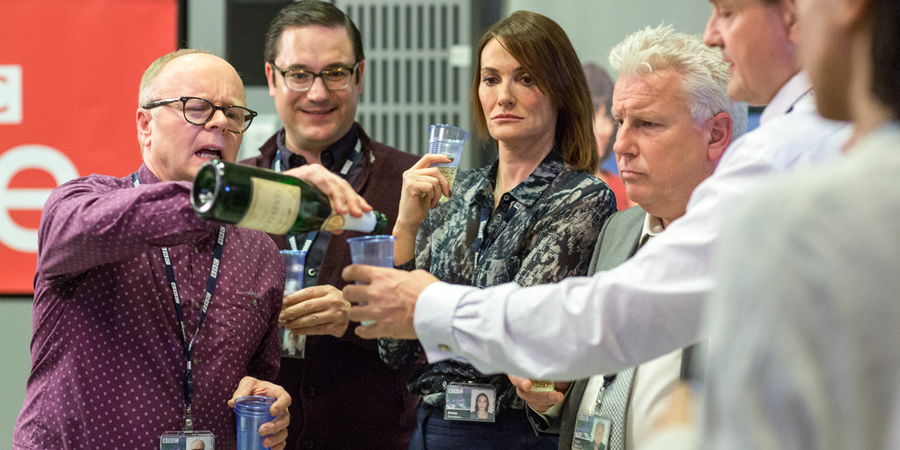 W1A. Image shows from L to R: Simon Harwood (Jason Watkins), David Wilkes (Rufus Jones), Anna Rampton (Sarah Parish), Neil Reid (David Westhead), Ian Fletcher (Hugh Bonneville). Copyright: BBC.
