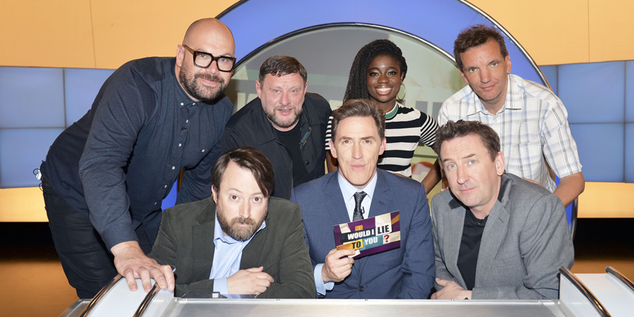 Would I Lie To You?. Image shows from L to R: Tom Davis, David Mitchell, Shaun Ryder, Rob Brydon, Clara Amfo, Lee Mack, Henning Wehn. Copyright: Zeppotron.
