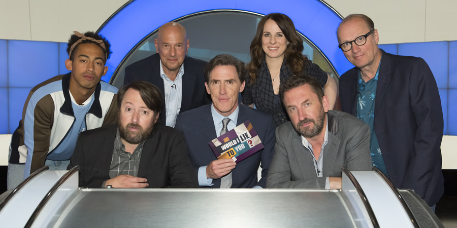 Would I Lie To You?. Image shows from L to R: Jordan Stephens, David Mitchell, Claude Littner, Rob Brydon, Cariad Lloyd, Lee Mack, Adrian Edmondson. Copyright: Zeppotron.
