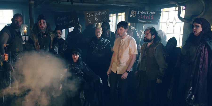 Zapped. Image shows from L to R: Herman (Louis Emerick), Howell (Paul Kaye), Henchwoman (Haruka Abe), Slasher Morgan (Sally Phillips), Unknown, Brian Weaver (James Buckley), Howell (Paul Kaye), Barbara (Sharon Rooney).
