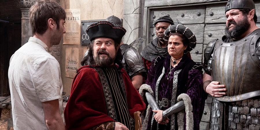 Zapped. Image shows from L to R: Brian Weaver (James Buckley), Steg Steggson (Ken Collard), Unknown, Judge (Nina Wadia), Spring Leaf (Richard Sandling).