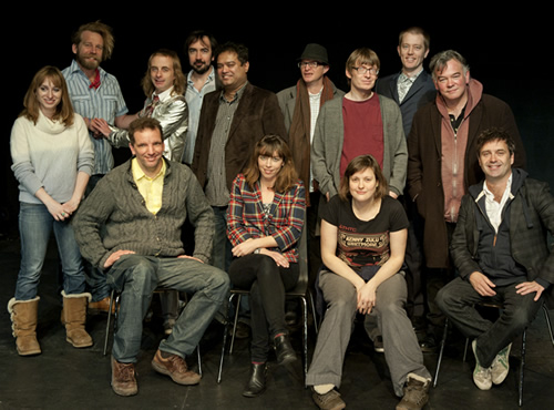The Alternative Comedy Experience. Image shows from L to R: Isy Suttie, Tony Law, Henning Wehn, Paul Foot, Stephen Carlin, Paul Sinha, Bridget Christie, Simon Munnery, David Kay, Josie Long, Alun Cochrane, Stewart Lee, Phil Nichol. Copyright: Comedy Central.