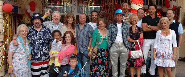 Benidorm Series 3. Image shows from L to R: Noreen Maltby (Elsie Kelly), The Oracle (Johnny Vegas), Donald Stewart (Kenny Ireland), Chantelle Garvey (Hannah Hobley), Janice Garvey (Siobhan Finneran), Michael Garvey (Oliver Stokes), Mick Garvey (Steve Pemberton), Paco (Kamal Simpson), Jacqueline Stewart (Janine Duvitski), Mel (Geoffrey Hutchings), Troy (Paul Bazely), Madge (Sheila Reid), Gavin (Hugh Sachs), Mateo (Jake Canuso), Brandy (Sheridan Smith), Martin Weedon (Nicholas Burns). Copyright: Tiger Aspect Productions.