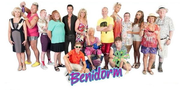 Benidorm. Image shows from L to R: Joyce (Sherrie Hewson), Kenneth (Tony Maudsley), Liam (Adam Gillen), Les / Lesley (Tim Healy), Mateo (Jake Canuso), Michael Garvey (Oliver Stokes), Janice Garvey (Siobhan Finneran), Madge (Sheila Reid), Mick Garvey (Steve Pemberton), Tiger Dyke (Danny Walters), Tonya Dyke (Hannah Waddingham), Clive Dyke (Perry Benson), Bianca Dyke (Bel Powley), Jacqueline Stewart (Janine Duvitski), Donald Stewart (Kenny Ireland). Image credit: Tiger Aspect Productions.