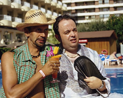 Benidorm. Image shows from L to R: Troy (Paul Bazely), Gavin (Hugh Sachs). Image credit: Tiger Aspect Productions.