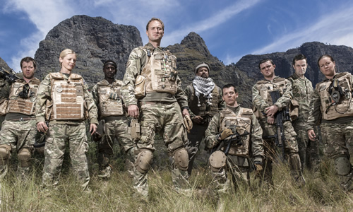 Bluestone 42. Image shows from L to R: Simon (Stephen Wight), Mary (Kelly Adams), Millsy (Gary Carr), Nick (Oliver Chris), Faruq (Keeno Lee Hector), Rocket (Scott Hoatson), Mac (Jamie Quinn), Lt Col Smith (Tony Gardner), Bird (Katie Lyons). Copyright: BBC.