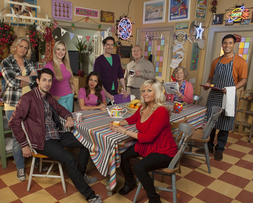 Edge Of Heaven. Image shows from L to R: Ann-Marie (Laura Checkley), Alfie (Blake Harrison), Ann-Marie (Laura Checkley), Michelle (Louisa Lytton), Camp Gary (Robert Evans), Bald Gary (Adrian Scarborough), Judy (Camille Coduri), Nanny Mo (Marcia Warren), Tandeep (Nitin Kundra). Image credit: Hartswood Films Ltd.