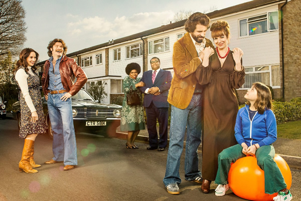 The Kennedys. Image shows from L to R: Jenny (Emma Pierson), Tim (Harry Peacock), Dee Palmer (Shola Adewusi), David Palmer (Clive Rowe), Tony Kennedy (Dan Skinner), Brenda Kennedy (Katherine Parkinson), Emma Kennedy (Lucy Hutchinson). Copyright: BBC.