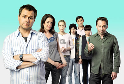 Lead Balloon. Image shows from L to R: Rick Spleen (Jack Dee), Mel (Raquel Cassidy), Magda (Anna Crilly), Ben (Rasmus Hardiker), Michael (Tony Gardner), Sam (Antonia Campbell-Hughes), Marty (Sean Power). Copyright: Open Mike Productions.