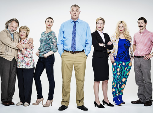 Man Down. Image shows from L to R: Dad (Rik Mayall), Mum (Gwyneth Powell), Naomi (Deirdre Mullins), Dan (Greg Davies), Emma (Jeany Spark), Jo (Roisin Conaty), Brian (Mike Wozniak). Image credit: Avalon Television.