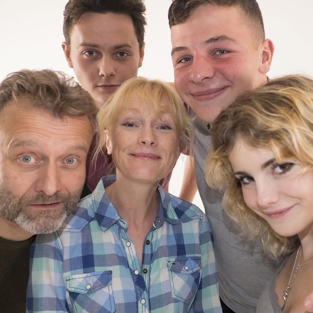 Outnumbered. Image shows from L to R: Pete (Hugh Dennis), Jake (Tyger Drew-Honey), Sue (Claire Skinner), Ben (Daniel Roche), Karen (Ramona Marquez).