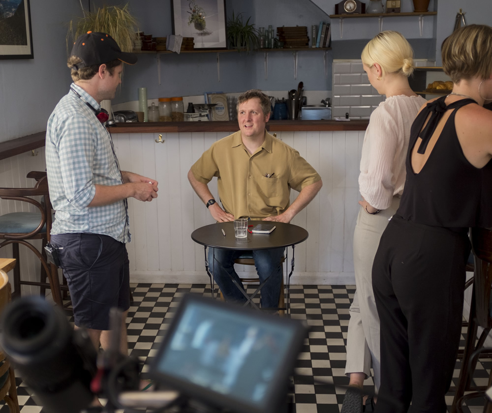 Regular. Image shows from L to R: David Elms, Regular (Tim Key), Barista (Laura Marling).