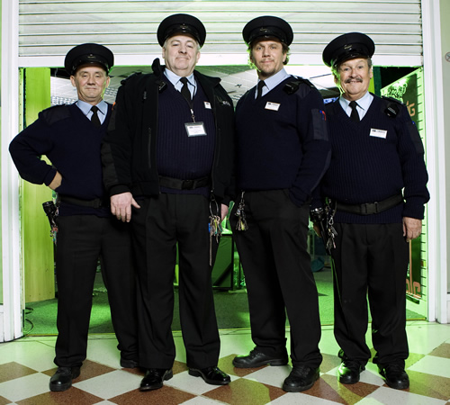 The Security Men. Image shows from L to R: Jimmy (Brendan O'Carroll), Kenneth (Peter Wight), Ray (Dean Andrews), Duckers (Bobby Ball). Image credit: ITV Studios.