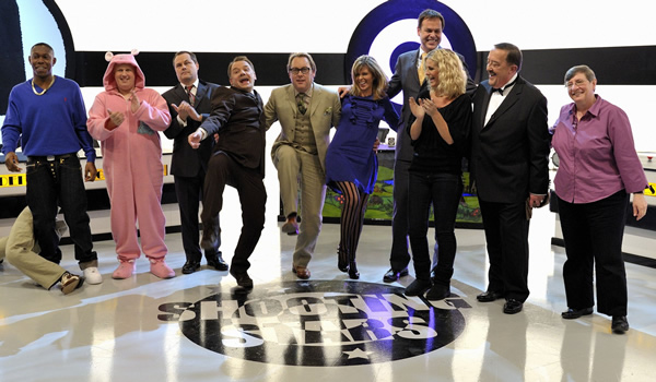 Shooting Stars. Image shows from L to R: Dylan Mills, George Dawes (Matt Lucas), Jack Dee, Bob Mortimer, Vic Reeves, Kate Garraway, Peter Jones, Ulrika Jonsson, Opera Singer (Stuart Kale), Christine Walkden. Copyright: Channel X / Pett Productions.
