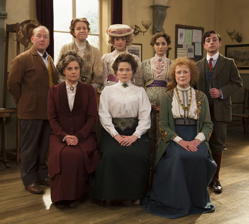 Up The Women. Image shows from L to R: Frank (Adrian Scarborough), Helen (Rebecca Front), Gwen (Vicki Pepperdine), Emily (Georgia Groome), Margaret (Jessica Hynes), Eva (Emma Pierson), Myrtle (Judy Parfitt), Thomas (Ryan Sampson). Image credit: British Broadcasting Corporation.