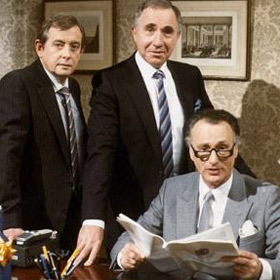 Yes Minister. Image shows from L to R: Bernard Woolley (Derek Fowlds), Sir Humphrey Appleby (Nigel Hawthorne), James Hacker (Paul Eddington). Copyright: BBC.