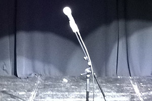 A microphone on a stage. Copyright: Ian Wolf.