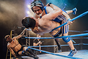 Ivan Gonzalez forces his competitor over the ropes as Joel Dommett looks on at The Wrestling 2017. Copyright: David Monteith-Hodge.