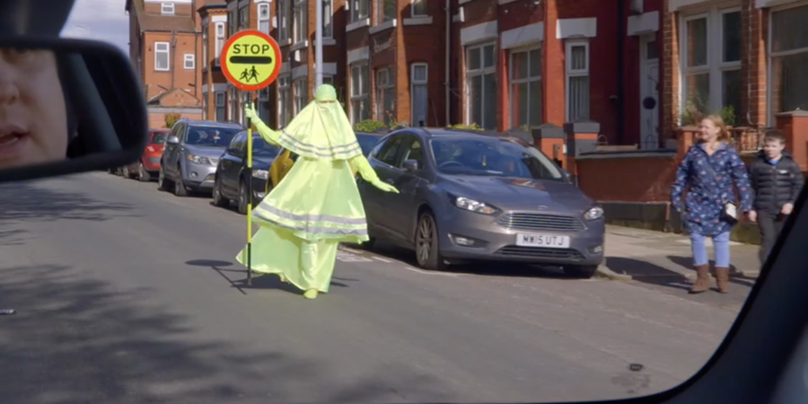 Lollypop lady wearing a florescent Burqa.