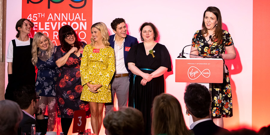 Derry Girls win at the BPG Awards 2019. Image shows from L to R: Louisa Harland, Nicola Coughlan, Liz Lewin, Saoirse-Monica Jackson, Dylan Llewellyn, Siobhán McSweeney, Lisa McGee. Copyright: BPG / Virgin Media.