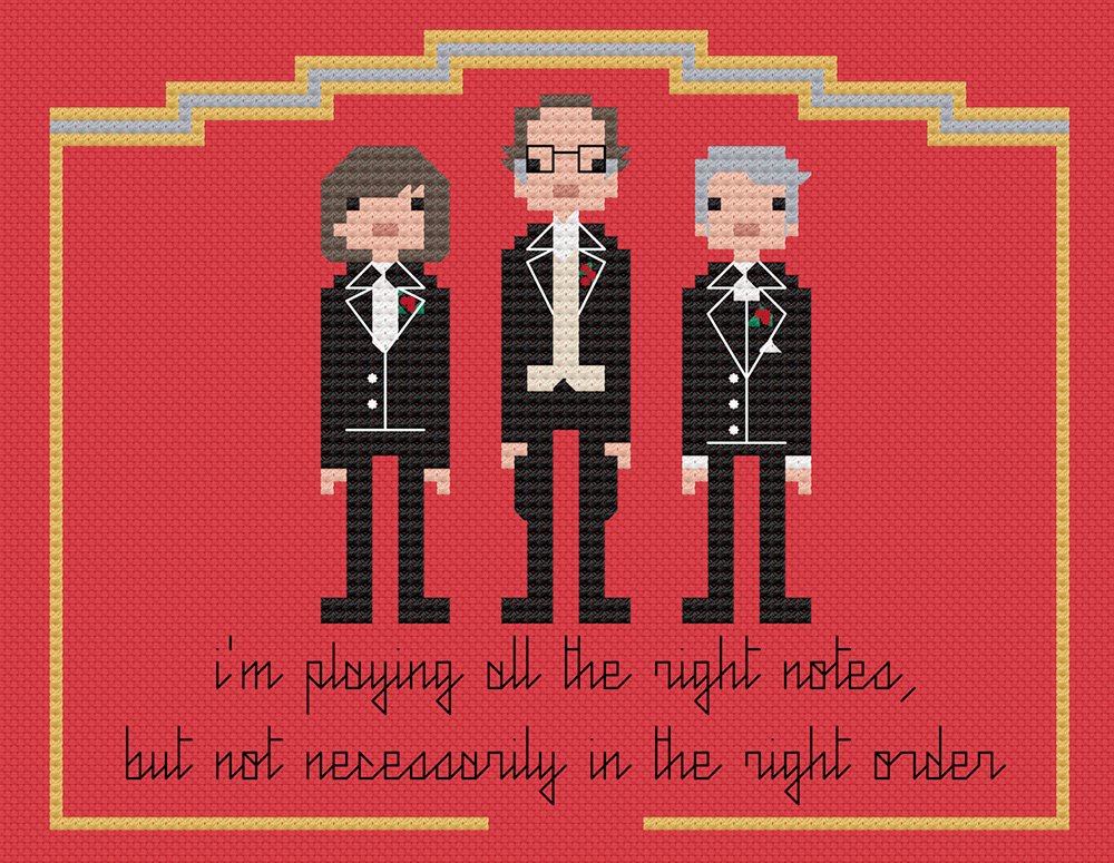Morecambe & Wise with André Previn in cross stitch.  Copyright: 8bitnorthxstitch.