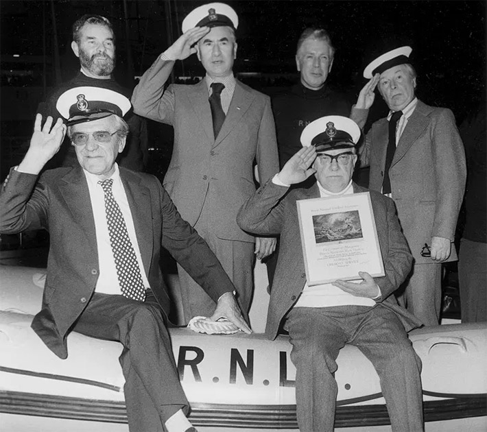 John Le Mesurier, Bill Pertwee, Arthur Lowe and Clive Dunn with two RNLI sailors at the 1977 Boat Show. Image shows from L to R: John Le Mesurier, Bill Pertwee, Arthur Lowe, Clive Dunn.