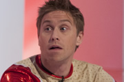 Russell Howard lubes up