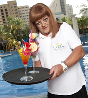 Benidorm. Les / Lesley (Tim Healy). Image credit: Tiger Aspect Productions.