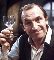 Rising Damp. Rupert Rigsby (Leonard Rossiter). Image credit: Yorkshire Television.
