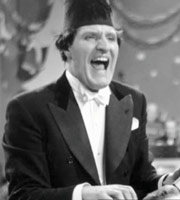 The Art Of Tommy Cooper. Tommy Cooper. Image credit: forgetaboutit.