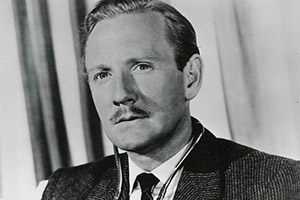 Please Turn Over. Dr. Henry Manners / 'Dr. Adam Gay' (Leslie Phillips). Copyright: STUDIOCANAL / Anglo Amalgamated.