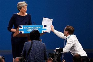 Image shows from L to R: Theresa May, Simon Brodkin.