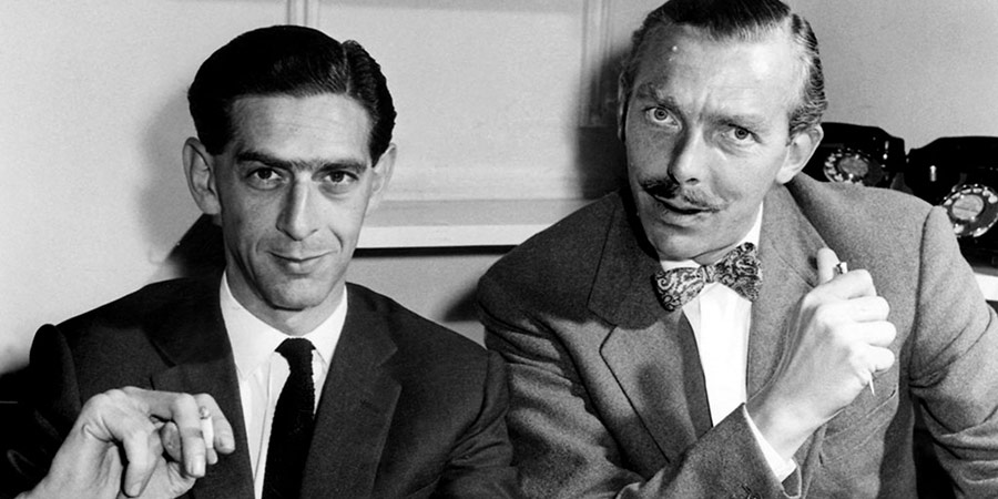 Image shows from L to R: Denis Norden, Frank Muir. Copyright: BBC.