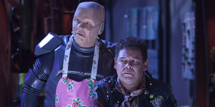 Red Dwarf. Image shows from L to R: Kryten (Robert Llewellyn), Lister (Craig Charles).