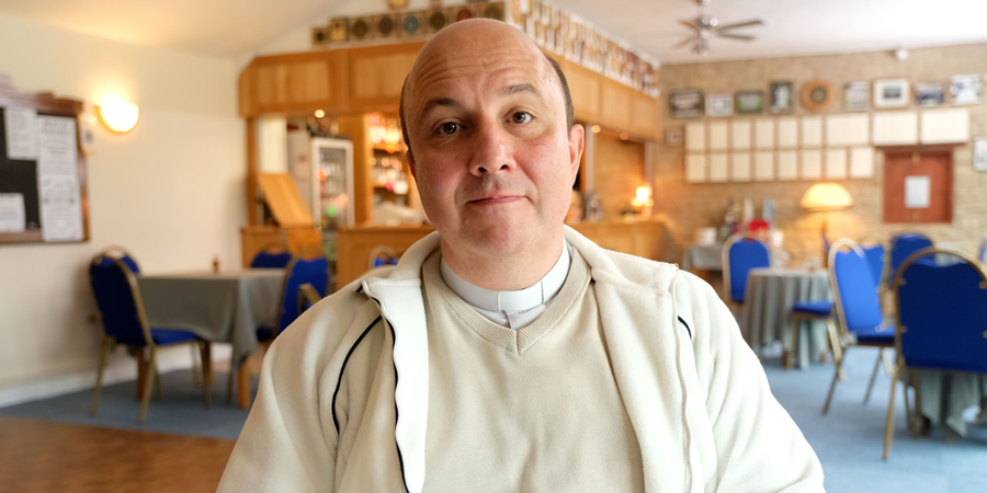 This Country. Reverend Francis Seaton (Paul Chahidi). Copyright: BBC.